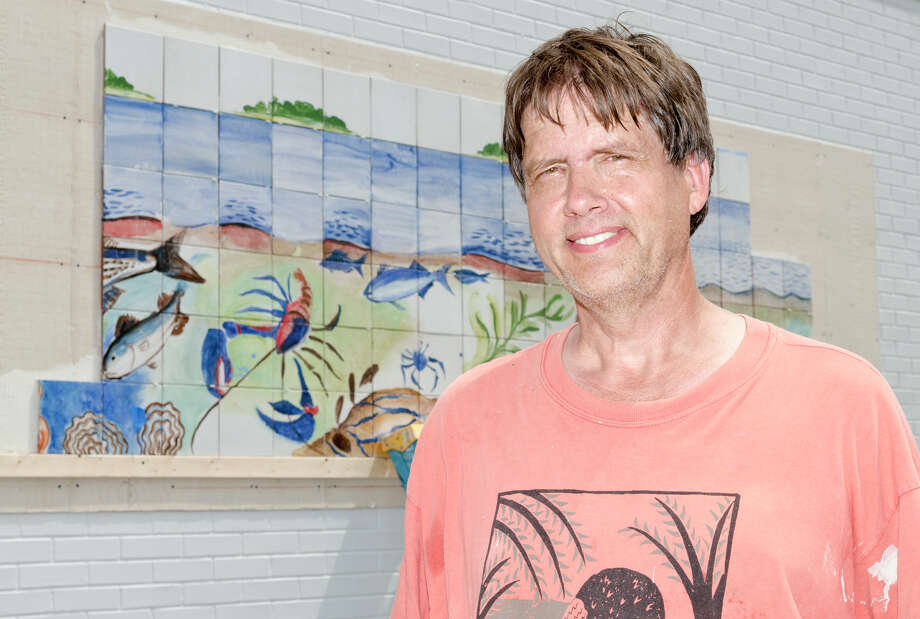Artist Kim Salander stands in front of his tile mural at Calf Pasture Beach in Norwalk on Saturday, July 27, 2013. The tiles for the mural were created by artists Kim Salander and Georgette Wirth, of Wirth Salander Custom Tile. Photo: Amy Mortensen / Connecticut Post Freelance