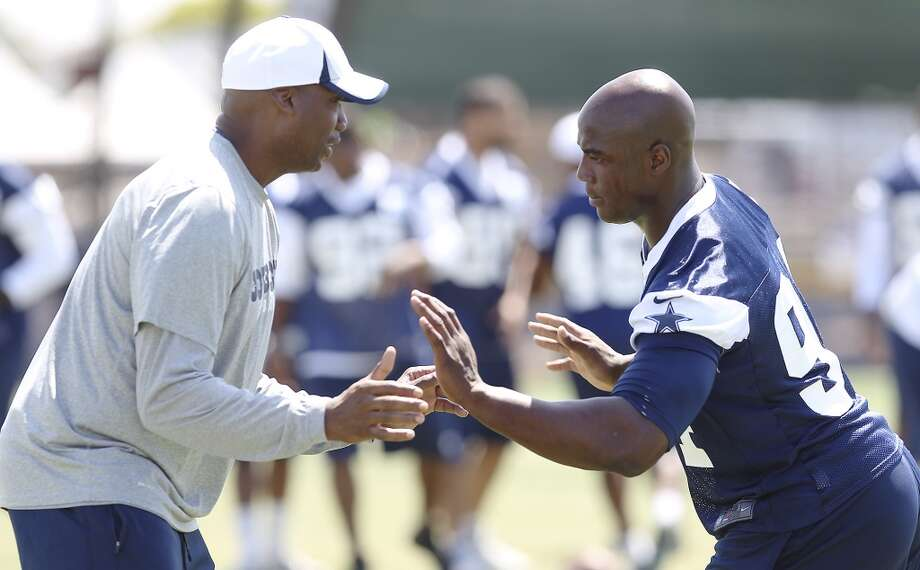 Defensive end DeMarcus Ware (right) works with defensive assistant coach Leon Lett during the morning session of the 2013 Dallas Cowboys training camp on Saturday, July 27, 2013 in Oxnard. (Kin Man Hui/San Antonio Express-News) Photo: San Antonio Express-News
