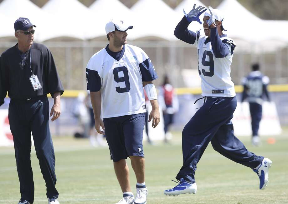 Receiver Austin Miles (19) works on drills with quarterback Tony Romo (09) during the morning session of the 2013 Dallas Cowboys training camp on Saturday, July 27, 2013 in Oxnard. (Kin Man Hui/San Antonio Express-News) Photo: San Antonio Express-News