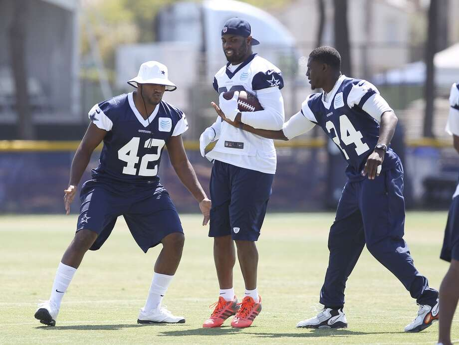 Safety Barry Church (42), running back DeMarco Murray (center) and cornerback Morris Claiborne (24) take part in practice during the morning session of the 2013 Dallas Cowboys training camp on Saturday, July 27, 2013 in Oxnard. (Kin Man Hui/San Antonio Express-News) Photo: San Antonio Express-News