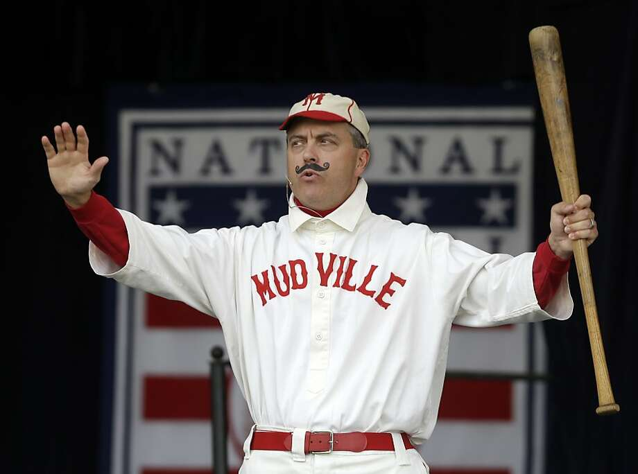 "Tim Wiles, the Baseball Hall of Fame director of research, portrays ""The Might Casey"" before an awards ceremony at Doubleday Field on Saturday, July 27, 2013, in Cooperstown, N.Y. It is the 125th anniversary of Ernest Lawrence Thayer's poem ""Casey at the Bat."" (AP Photo/Mike Groll) Photo: Mike Groll, Associated Press"