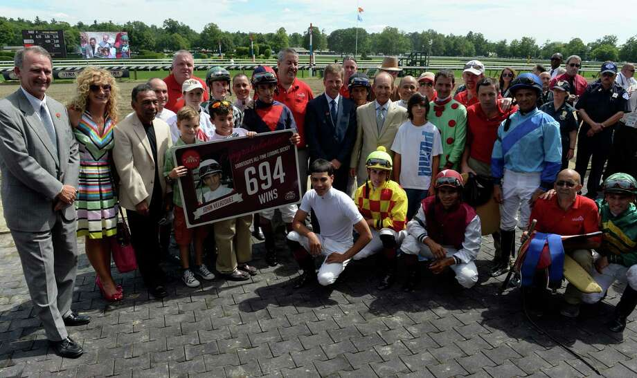 Jockey John Velazquez is all smiles as he is surrounded by well wishers July 27, 2013 after his win in the fourth race and breaking the record for the most wins by any jockey in the history of the Saratoga Race Course in Saratoga Springs, N.Y.   (Skip Dickstein/Times Union) Photo: SKIP DICKSTEIN