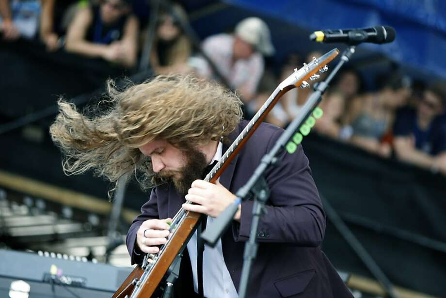 Jim James performs at the 54th edition of the Newport Folk Festival in Newport, R.I. on Saturday, July 27, 2013.  With acts appearing on four stages, the sold out festival continues through Sunday.  (AP Photo/Joe Giblin) Photo: Joe Giblin, Associated Press