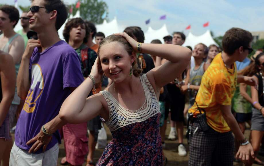 Lilly Roberts, 16, of Chicopee, MA, dances as The Roots perform during the 18th annual Gathering of the Vibes Musical Festival at Seaside Park in Bridgeport, Conn. Saturday, July 27, 2013. Photo: Autumn Driscoll / Connecticut Post freelance