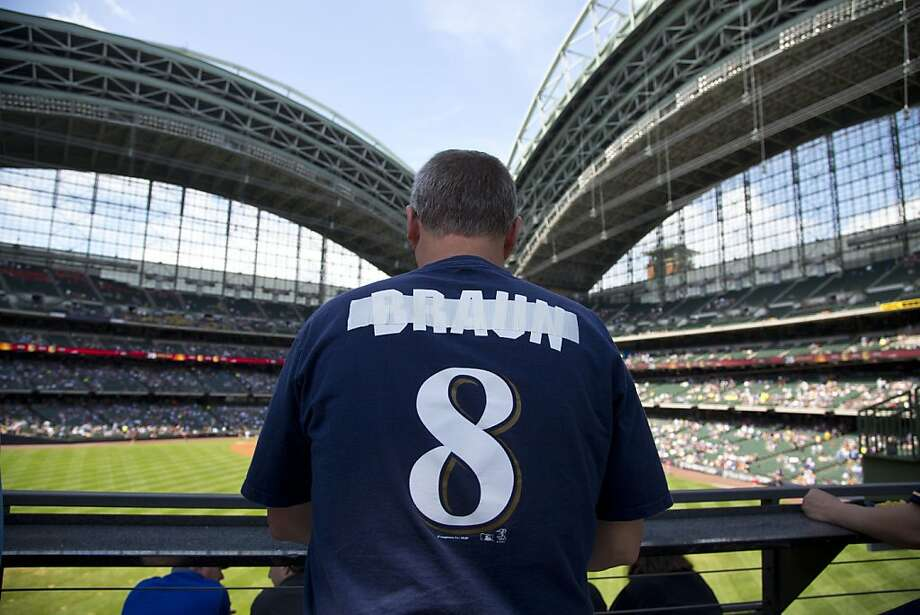 A Brewers fan covers up Ryan Braun's name on his shirt before a game last week in Milwaukee. Braun has been suspended for the rest of the season after being linked to the Biogenesis lab. Photo: Jeffrey Phelps, Associated Press