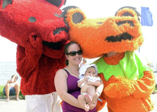 Lisa Mello, of Milford, and her 3-month-old daughter Rosalee take a picture with Grateful Dead Bears during the 18th annual Gathering of the Vibes Musical Festival at Seaside Park in Bridgeport, Conn. Saturday, July 27, 2013. Photo: Autumn Driscoll / Connecticut Post freelance