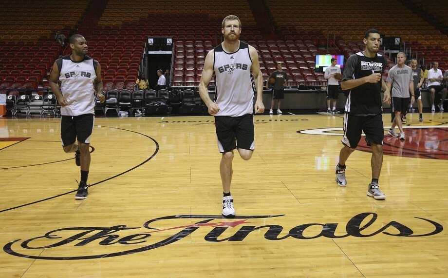 San Antonio Spurs' Gary Neal, Matt Bonner and Danny Green warm up during practice and media sessions at the at American Airlines Arena on Wednesay, June 19, 2013 in Miami. (Edward A. Ornelas/San Antonio Express-News) Photo: San Antonio Express-News