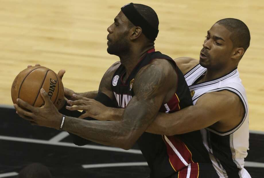 Miami Heat's LeBron James is wrapped up by San Antonio Spurs' Gary Neal during the first half of Game 4 of the NBA Finals at the AT&T Center on Thur., June 13, 2013. (Jerry Lara/San Antonio Express-News) Photo: San Antonio Express-News