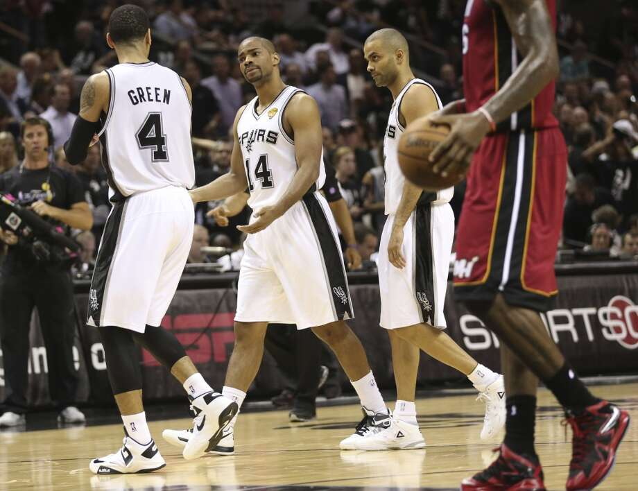 San Antonio Spurs' Gary Neal talks with San Antonio Spurs' Danny Green, left, while the two walk to the sideline with San Antonio Spurs' Tony Parker during the first half of Game 3 of the NBA Finals at the AT&T Center on Tue., June 11, 2013. Photo: San Antonio Express-News