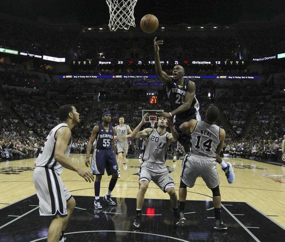 Memphis Grizzlies' Quincy Pondexter (20) attempts a shot against Spurs' Gary Neal (14) and Manu Ginobili (20) in the second half of Game 1 of the 2013 Western Conference Finals at the AT&T Center on Sunday, May 19, 2013. Spurs won 105-83. Photo: San Antonio Express-News