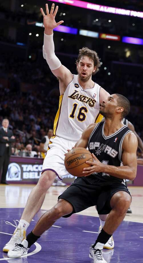 San Antonio Spurs' Gary Neal looks for room around Los Angeles Lakers' Pau Gasol during first half action of game 4 in the first round of the NBA Playoffs Sunday April 28, 2013 at the Staples Center in Los Angeles, CA. Photo: San Antonio Express-News