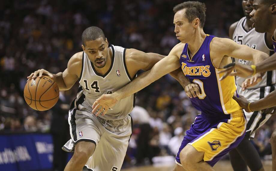 San Antonio Spurs' Gary Neal drives around Los Angeles Lakers' Steve Nash in the the first half of game 2 in the first round of the NBA Playoff at the AT&T Center, Wednesday, April 24, 2013. Photo: San Antonio Express-News