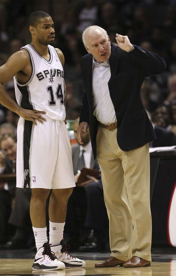 San Antonio Spurs head coach Gregg Popovich talks with Gary Neal during during a break against the Orlando Magic at the AT&T Center, Wednesday, April 3, 3013. The Spurs won 98-84. Photo: Jerry Lara, San Antonio Express-News