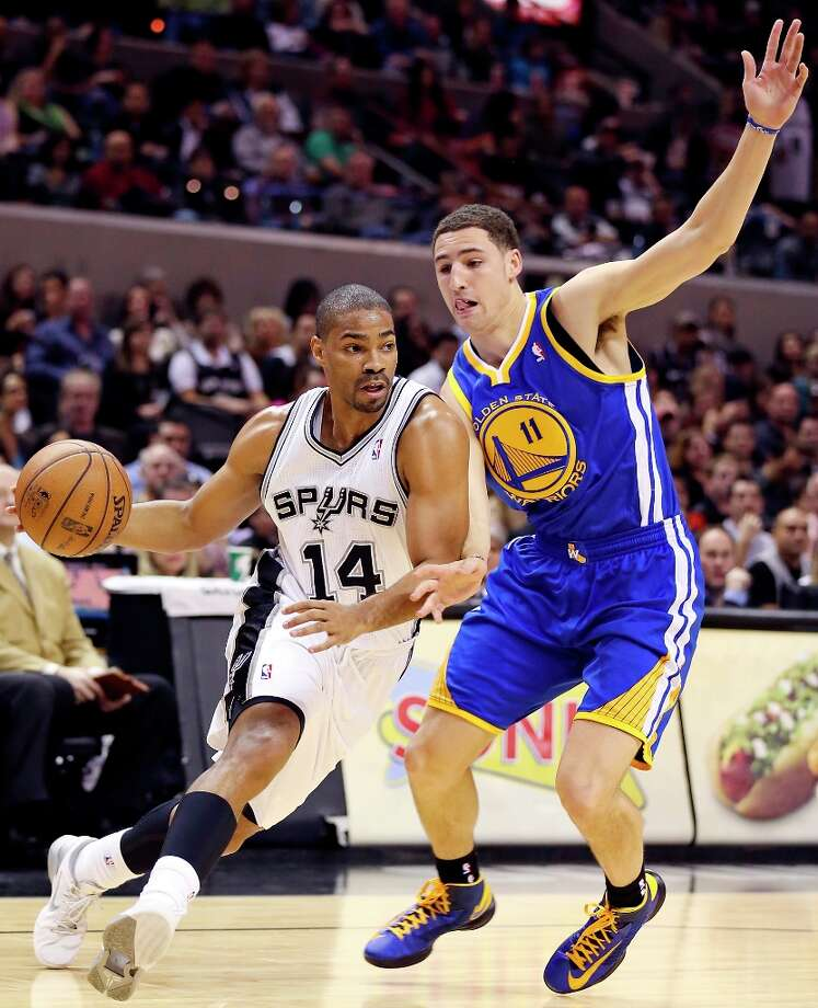 the Spurs' Gary Neal looks for room around Golden State Warriors' Klay Thompson during first half action Friday, Jan. 18, 2013 at the AT&T Center. Photo: Edward A. Ornelas, San Antonio Express-News / © 2012 San Antonio Express-News