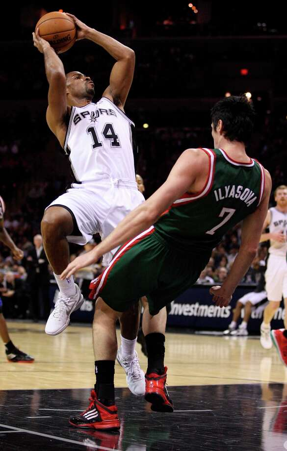The Spurs' Gary Neal goes for two against Milwaukee Bucks' Ersan Ilyasova during the second half at the AT&T Center, Wednesday, Nov. 5, 2012. The Spurs won 110-99. Neal ended the game with 22 points. Photo: Jerry Lara, San Antonio Express-News / © 2012 San Antonio Express-News
