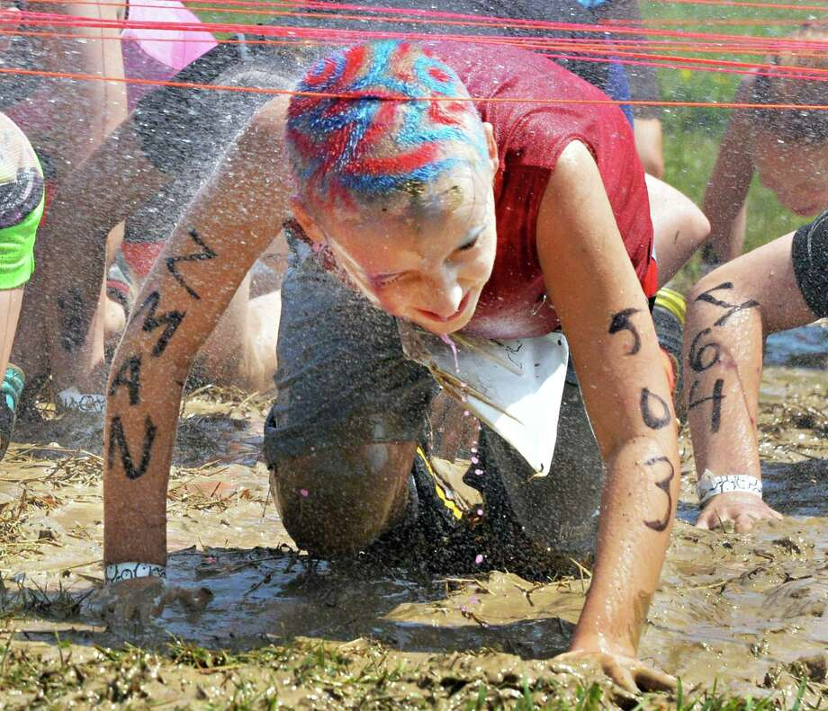 Zach Zinzow, 9, of Watervliet crawls under an obstacle during the 2K Family event at the 2013 Run the Ridge Mud Run hosted by Maple Ski Ridge in Mariaville, NY, on Saturday July 27, 2013. (John Carl D'Annibale / Times Union) Photo: John Carl D'Annibale / 00023252A