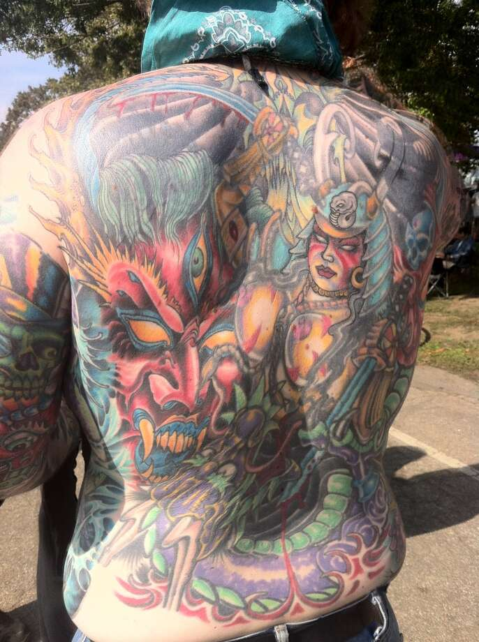 Mark Tawney, 40, of Philadelphia, shows off his tattoo at Gathering of the Vibes on Saturday, July 28, 2013.
