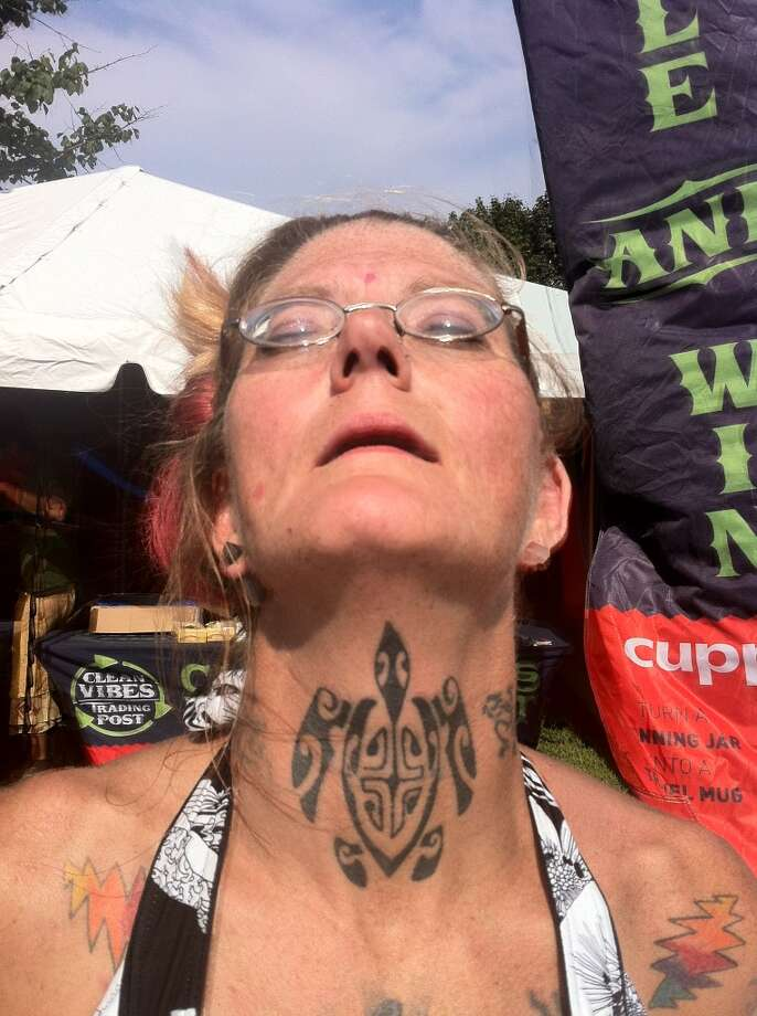 Georgie Galler, of Fairfield, shows off her terrapin tattoo at the Gathering of the Vibes on Saturday, July 28, 2013.