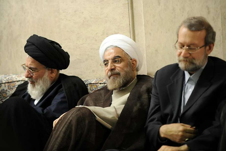 President-elect Hassan Rouhani (center) is flanked by Iran's judiciary chief and speaker of parliament. Photo: Ho, AFP/Getty Images