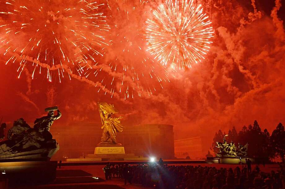 """Fireworks explodebefore the """"Victorious Fatherland War Museum"""" in Pyongyang during a   show marking the 60th anniversary of the Korean war armistice. North Korea mounted its   largest-ever military parade for the holiday, displaying its long-range missiles at a   ceremony presided over by leader Kim Jong-Un. Photo: Giles Hewitt, AFP/Getty Images"""
