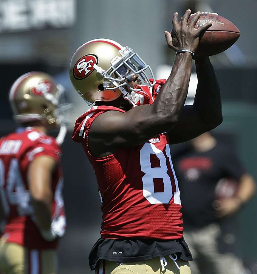 San Francisco 49ers' Anquan Boldin makes a reception during NFL football training camp onFriday, July 26, 2013, in Santa Clara, Calif. (AP Photo/Ben Margot) Photo: Ben Margot, Associated Press