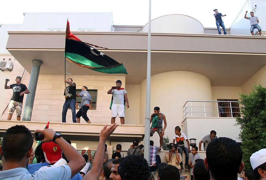 Libyan protesters attack the offices of Muslim Brotherhood-backed Party of Justice and Construction, in the Libyan capital Tripoli on July 27, 2013.  Protesters attacked offices of Libya's Muslim Brotherhood as demonstrations sparked by a wave of assassinations in the eastern city of Benghazi turned violent, an AFP correspondent said.   AFP PHOTO/MAHMUD TURKIAMAHMUD TURKIA/AFP/Getty Images Photo: Mahmud Turkia, AFP/Getty Images