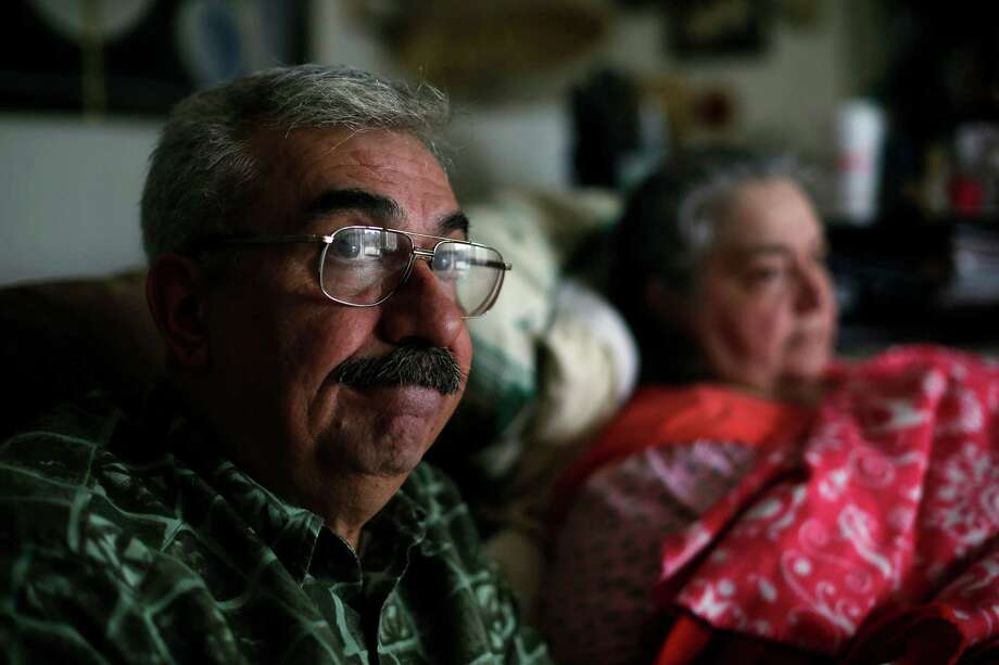 Sergio Alvarado, left, and his wife Tina, who is disabled with various health issues, sit in their home in Round Lake, Illinois, July 9, 2013. Sergio, an investor, was awarded more than $700,000 in damages in 2012 after a dispute with his brokerage went through arbitration. But almost a year later, Alvarado still hasn't been able to collect. (Jose M. Osorio/Chicago Tribune/MCT) Photo: Jose M. Osorio / Chicago Tribune