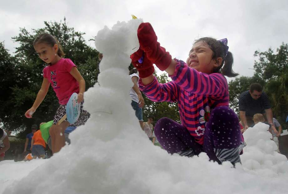Nikki Maldonado, 5, reacts a tumbling snowball during TXU Energy Snow Day at the Houston Zoo on Saturday, July 27, 2013, in Houston. Photo: Mayra Beltran, Houston Chronicle / © 2013 Houston Chronicle