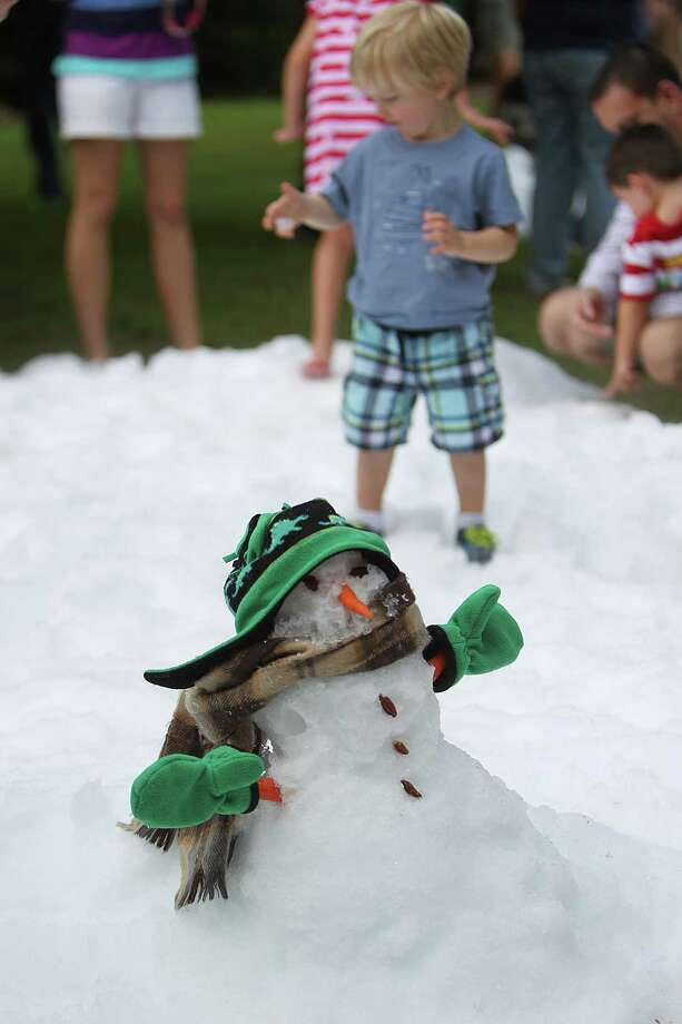 A well dressed snowman was made during TXU Energy Snow Day at the Houston Zoo on Saturday, July 27, 2013, in Houston. Photo: Mayra Beltran, Houston Chronicle / © 2013 Houston Chronicle