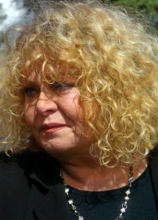 "Actress Sally Struthers, center, who played Archie Bunker's daughter Gloria on television's ""All in the Family,"" arrives at St. Paul the Apostle Roman Catholic Church in Los Angeles for the funeral of actor Carroll O'Connor on in this file photo from from June 26, 2001.   The 58-year-old actress co-stars in ""What I Did For Love,"" airing Saturday on the Hallmark Channel. Struthers plays a nosy aunt whose niece returns with her new fiance to her small hometown, where tradition calls for him to seek her parents' consent to the marriage. (AP Photo/Lee Celano-File) Photo: LEE CELANO / AP"