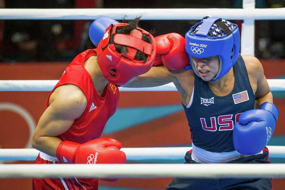 """Marlen Esparza, right, calls her loss to Cancan Ren in last summer's Olympics the """"worst moment of her life"""" after it cost her a shot at the gold medal. Photo: Smiley N. Pool, Staff / © 2012  Houston Chronicle"""