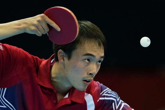 Timothy Wang of Houston serves against Kim Song Nam of the People's Republic of Korea in the men's singles preliminary round of table tennis at the 2012 London Olympics on Saturday, July 28, 2012. ( Smiley N. Pool / Houston Chronicle)