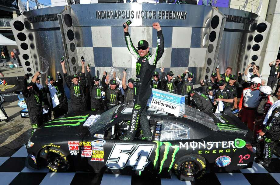Kyle Busch celebrates after winning the NASCAR Nationwide Series auto race at ndianapolis Motor Speedway in Indianapolis, Saturday, July 27, 2013. (AP Photo/Doug McSchooler) ORG XMIT: NAA145 Photo: Doug McSchooler / FR170771 AP