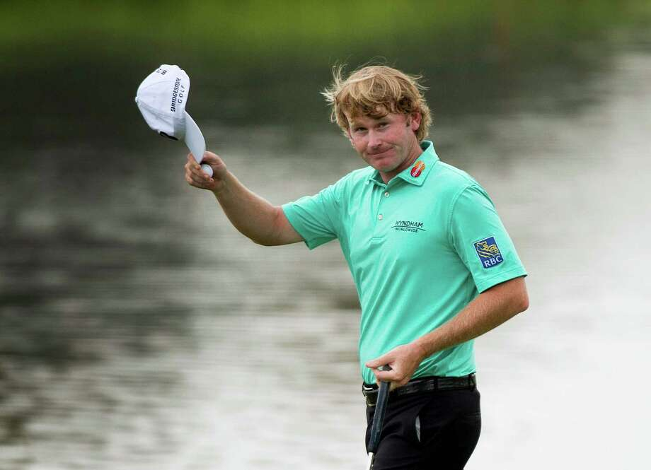 Brandt Snedeker reacts to the crowed after finishing his round on the 18th hole during the third round of the Canadian Open golf tournament at Glen Abbey in Oakville, Ontario, Saturday, July 27, 2013. (AP Photo/The Canadian Press, Nathan Denette) ORG XMIT: NSD114 Photo: Nathan Denette / CP
