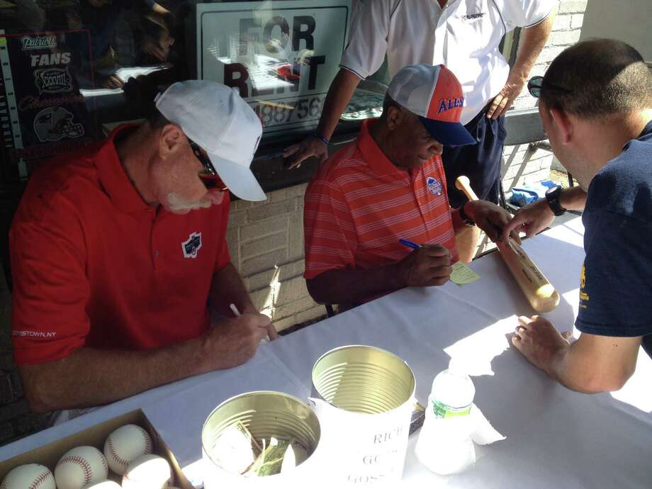 Hall of Famers Goose Gossage, left, and Frank Robinson signs autographs in Cooperstown on Saturday, July 27, 2013. (Pete Iorizzo / Times Union)
