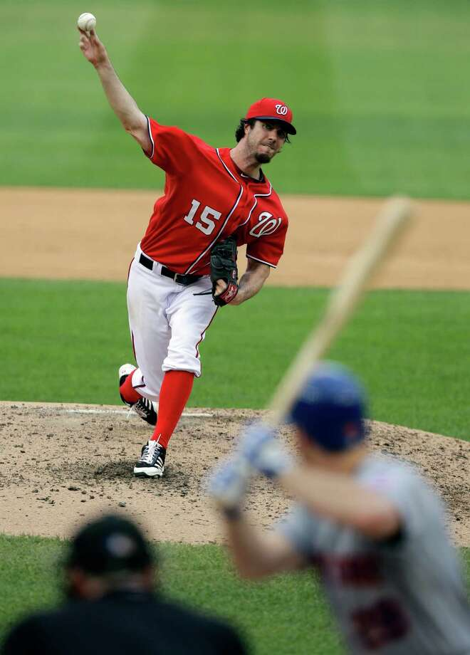 Washington Nationals starting pitcher Dan Haren (15) throws to New York Mets' Daniel Murphy during the sixth inning of a baseball game at Nationals Park Saturday, July 27, 2013, in Washington. (AP Photo/Alex Brandon) ORG XMIT: NAT110 Photo: Alex Brandon / AP