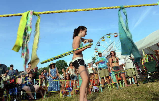 Cassie Silverman, 14, of Carlisle, PA, competes in a hoop contest during the 18th Annual Gathering of the Vibes music festival at Seaside Park in Bridgeport, Conn. on Saturday July 27, 2013. Photo: Christian Abraham / Connecticut Post freelance