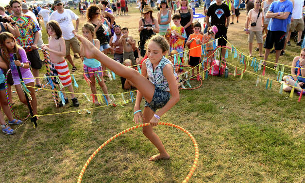Emory Ciocci, of Stamford, competes in a hoop contest during the 18th Annual Gathering of the Vibes music festival at Seaside Park in Bridgeport, Conn. on Saturday July 27, 2013. Photo: Christian Abraham / Connecticut Post freelance