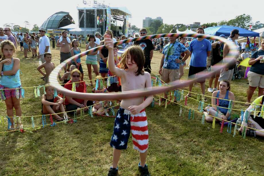 Hayden Silverman, 10, of Carlisle, PA competes in a hoop contest, during the 18th Annual Gathering of the Vibes music festival at Seaside Park in Bridgeport, Conn. on Saturday July 27, 2013. Photo: Christian Abraham / Connecticut Post freelance
