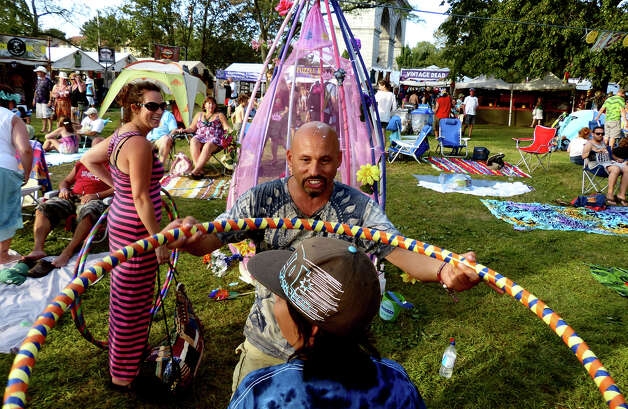 Richard Ferrano, of New Paltz, NY, shakes a hoop over Thomas Colon, a native of Bridgeport, as he goes through the Karma Wash, during the 18th Annual Gathering of the Vibes music festival at Seaside Park in Bridgeport, Conn. on Saturday July 27, 2013. Photo: Christian Abraham / Connecticut Post freelance