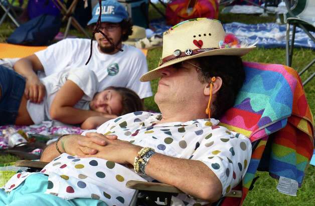 Scott Taylor, of Bridgeport, takes a nap during the 18th Annual Gathering of the Vibes music festival at Seaside Park in Bridgeport, Conn. on Saturday July 27, 2013. Photo: Christian Abraham / Connecticut Post freelance