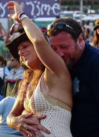 Cindy Grossman and high school friend Ira Sokowitz dance during the 18th Annual Gathering of the Vibes music festival at Seaside Park in Bridgeport, Conn. on Saturday July 27, 2013. Photo: Christian Abraham / Connecticut Post freelance