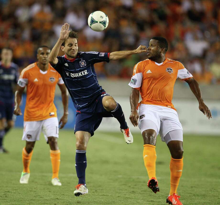 Chicago Fire forward Mike Magee (9) battles against Houston Dynamo defender Jermaine Taylor (4) during the first half of the Houston Dynamo MLS soccer game at BBVA Compass Stadium, Saturday, July 27, 2013, in Houston. Photo: Karen Warren, Houston Chronicle / © 2013 Houston Chronicle