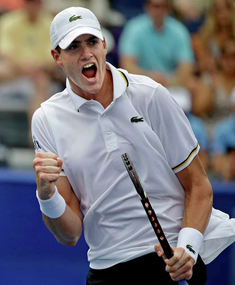 John Isner reacts after winning the first set against Lleyton Hewitt, of Australia, in a semifinal match at the Atlanta Open tennis tournament, Saturday, July 27, 2013, in Atlanta. (AP Photo/David Goldman) ORG XMIT: GADG107 Photo: David Goldman / AP