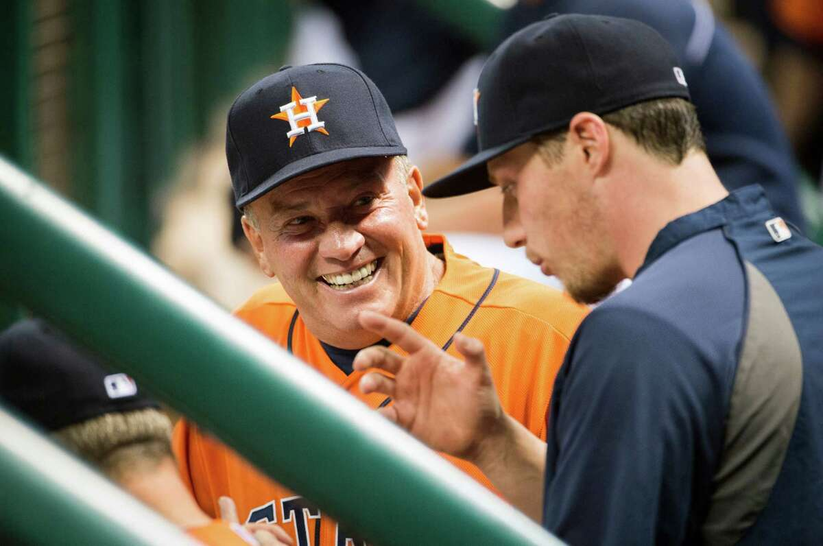 Houston Astros third base coach Dave Trembley laughs with pitcher Lucas Harrell before a game against the Oakland Athletics at Minute Maid Park on Friday, May 24, 2013, in Houston. ( Smiley N. Pool / Houston Chronicle )