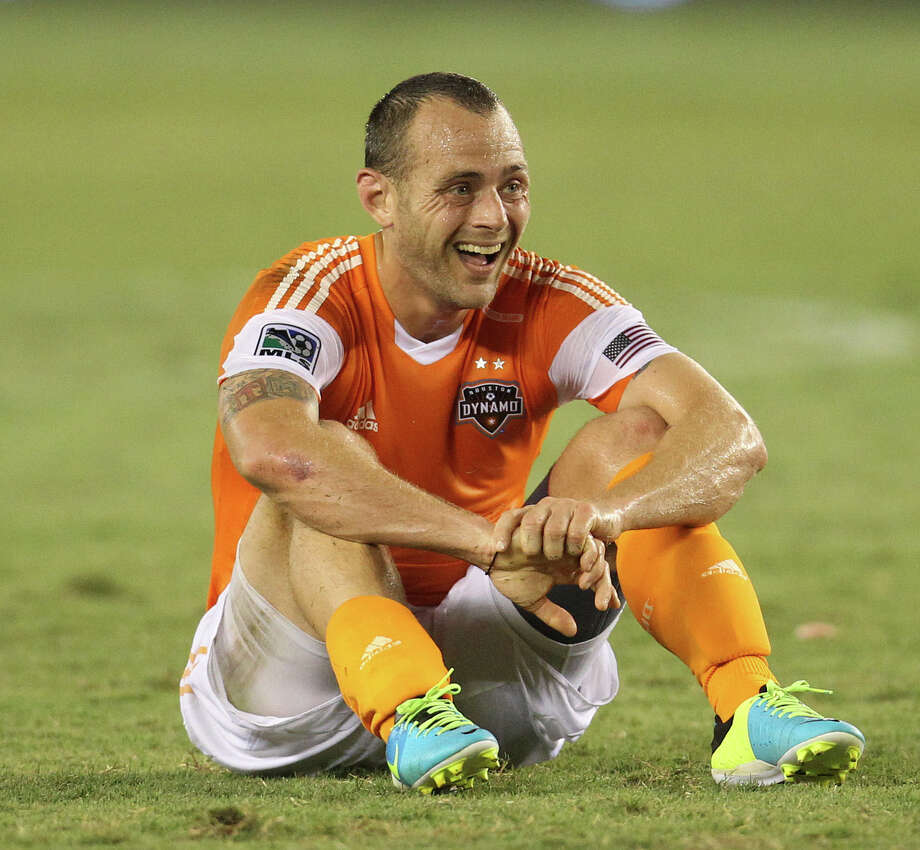 Houston Dynamo midfielder Brad Davis (11) sits on the ground after a play during the second half of the Houston Dynamo MLS soccer game at BBVA Compass Stadium, Saturday, July 27, 2013, in Houston. Score was tied 1-1. Photo: Karen Warren, Houston Chronicle / © 2013 Houston Chronicle