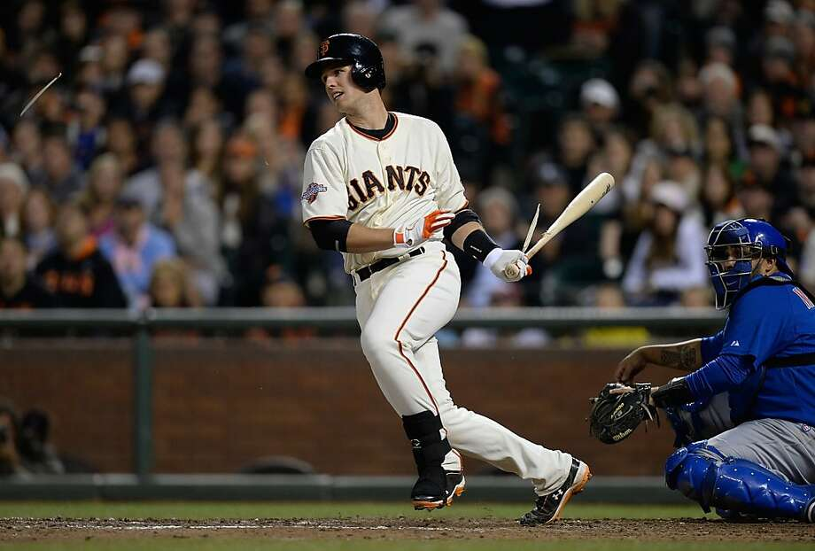 Buster Posey shatters his bat with the bases loaded and no one out in the eighth. Gregor Blanco was out at home on the play. Photo: Thearon W. Henderson, Getty Images