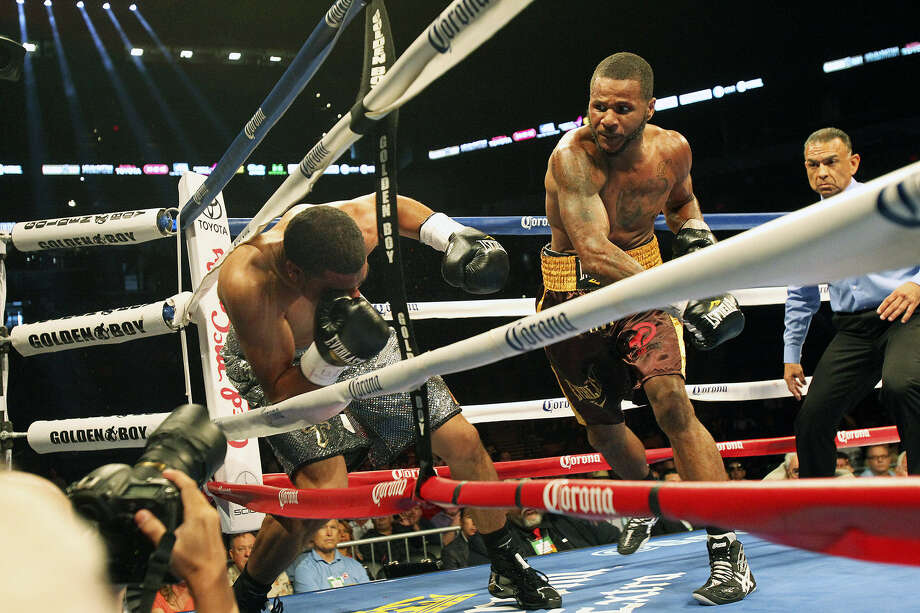 "Anthony Dirrell pounds Anthony Hanshaw into the ropes to secure a technical knockout in the third round during an undercard bout on the ""Knockout Kings II"" card at the AT&T Center on Saturday. Photo: Photos By Tom Reel / San Antonio Express-News"