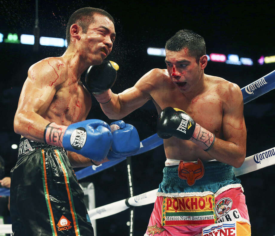 "Omar Figueroa (right) of Weslaco connects to the chin of Japan's Nihito Arakawa at ""Knockout Kings II"" at the AT&T Center. Photo: Tom Reel / San Antonio Express-News"