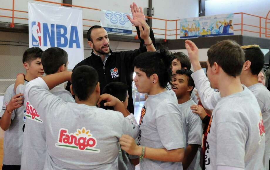 Spurs guard Manu Ginobili, who recently spent time with Special Olympians in Buenos Aires, is fired up to keep playing. Photo: Courtesy Photo